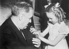 President buys a Buddy Poppy - 28-April-1943. Seven year old Florence Ollila sold the first Buddy Poppy - in aid of war relief work - to President Roosevelt at the White House. The little girl, daughter of a deceased ex-serviceman, travelled from a war orphans home in Michigan to have the honour of selling to the President. (Photo by Planet News Archive/SSPL/Getty Images)