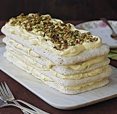 Pistachio-flecked meringue layers contrast a tangy, creamy lemon curd filling in this stunning dacquoise. Perfect for a special occasion, this make-ahead dessert needs at least 24 hours in the refrigerator before serving to soften a bit. Pavlova, Make Ahead Desserts, Just Desserts, Dacquoise Recipe, Lemon Curd Filling, French Pastries, Pistachio, Cheesecakes, Cake Recipes