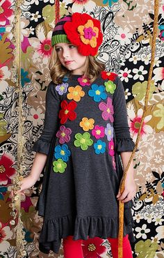 aw15: The elegant drape of Lemon Loves Lime's cotton knit Harvest Dress, and its garden of bright crocheted blooms, scored big points with buyers. www.lemonloveslime.com (buyers' pick)