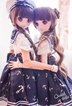 Millhie (Dollfie Dream Sister Millhiore) & Melocotón (custom Dollfie Dream Sister M.O.M.O.) http://orchiddolls.wordpress.com/