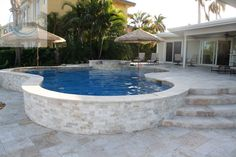 This pool-jacuzzi combo has a definite refinement due to the Travertine Marble Pavers that were used for the remodeling.