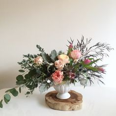 Succulents, airplants and gorgeous garden roses help to complete this unique Valentine's Day floral arrangement 912-439-3298 for pick up locally today and tomorrow