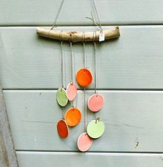 Ceramic wall hanging with pink flowers hanging on a weathered stick. Jardin Decor, Hanging Flower Wall, Ceramic Flowers, Artisanal, Decoration, Wind Chimes, Etsy, Outdoor Decor, Home Decor