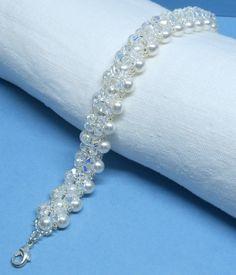 Perle Swarovski und Kristall Armband Swarovski Gemacht mit Swarovski Perlen,Kristall und japanischen Rocailles.