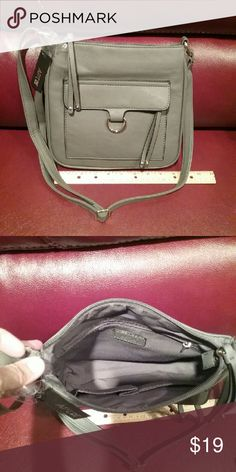 """NWT Apt. 9 Grey Crossbody *Final Price This crossbody is about 9"""" by 9"""" with an adjustable strap.  There is a small zippered pocket on the front of the bag. Inside is a small zippered section on one side, and 2 pockets on the other.   The back is plain.  This is a final price item, but you can still save 15% when you bundle. Apt. 9 Bags Crossbody Bags"""