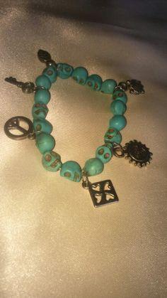 Skull and charms bracelet