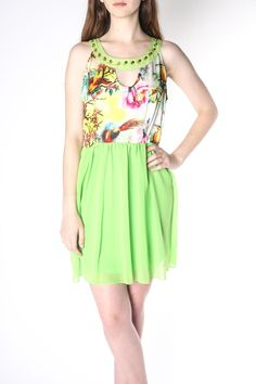 Beautiful Lime Green baby Doll Dress! Cut beautifully for a flowy and romantic look with lively whimsical print in the top front. It's higher neck line is cut in Grecian style which makes for a classy, elegant look and its bold green color is sure to be a lively addition to your casual dresses! Stylish and cut in the adorable baby doll dress look, very vintage inspired, can be worn with gold ballet flats or your cutest sandals for that summer look!   Lime Babydoll Dress  by Grifflin Paris…