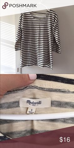 """Madewell Striped 3/4 Sleeve Top This dark grey and white striped top is in good used condition and has been worn a handful of times. I would say it's a little oversized in fit and the weight is a little more substantial than just a regular tee. There are no holes, stains, or other imperfections to note. When laying flat it measures approx 26"""" in length. Madewell Tops"""