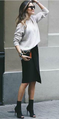 Alex Rivière + elegant black pencil skirt + cream sweater + heeled open toe boots + spring style + pair of shades + get this look! Bag: Sandro Paris.