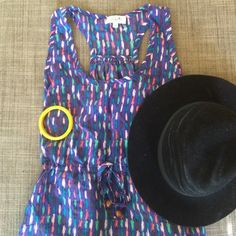 Colorful scoop neck, tback dress, great for spring Colorful dress, double lined on the skirt. Like new, barely worn, size two, has two adorb wood beads on the the pull tie center. T back dress, scoop neck front  Dresses