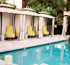 Hollywood Regency Cabanas accented by yellow chairs at Viceroy Palm Springs #design #travel