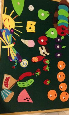Felt board, (own made) the very hungry caterpillar encourages day-names of the week in sequential order and numeracy.