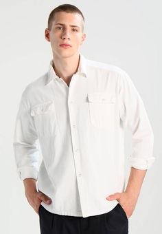 """AllSaints. TWIST - Shirt - vintage white. Fit:Regular. Outer fabric material:100% cotton. Our model's height:Our model is 74.5 """" tall and is wearing size M. Pattern:plain. Care instructions:machine wash at 40°C. Fastening:button. Length:no..."""