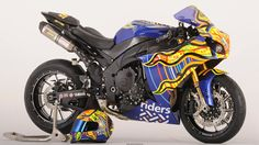"Custom 2009 Yamaha YZF-R1 - featuring Valentino Rossi's ""Five Continents"" graphics by Aldo Drudi.  Proceeds benefiting Riders For Health."