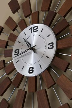 Pixel Wall Clock This atomic wall clock is from a model of clocks designed by Seth Thomas called Grandeur; which was inspired by the iconic design of the Pixel clock by George Nelson. It was manufactured in the 1960s, and has a design of 3 concentric circles formed with 32 spokes carrying wooden pieces which can be adjusted to alter the clock's shape a little at you whim. Its dimensions are 25 1/2 inches total Diameter, and 9 inches across the main clock. It is a beautiful piece, with the…