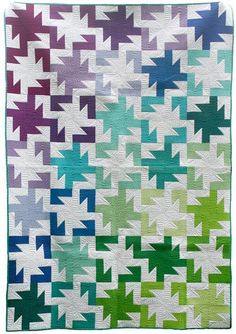 Sparkler quilt pattern by Freshly Pieced at Craftsy.  Originally seen in the Spring 2013 issue of Fons & Porter's Easy Quilts. This easy-to-piece block makes a tessellating pattern.