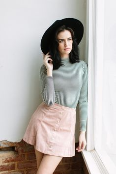 Sweet, but ever so cool. The Maggie May suede skirt features a perforated suede fabric, button up front, and high waist skater skirt cut. Rock it with boots and a knotted graphic tee for style perfect