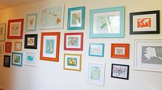 Would be a cute way to display kids' artwork in the playroom hallway! :) map wall, photo gallery, frame gallery
