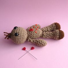 Brown Voodoo Doll with a heart.