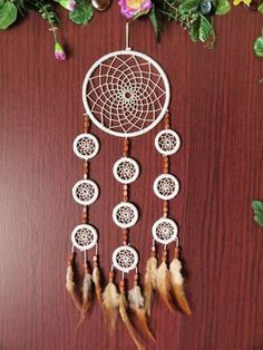 10 rings, natural white dream catcher with a little touch of brown white rope natural colors natural feathers wood beads approx size: 12x60 cm (5x24 inch) It brings love, light and positive energy and allows only your good dreams to slip down the feathers to bless you while youre