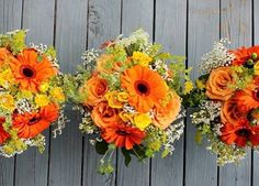 For Monica's #bridesmaids smaller versions of her own #bridalbouquet.  #thefloralcottageflorist #throwbackthursday #tbt #orangeandyellow #springwedding #gerberdaisies #bridesmaidsbouquet #bridesmaidbouquet