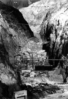 This undated view, looking upstream through the Black Canyon, shows the giant concrete forms covering the finished base of the Hoover Dam as construction continued in Boulder City, Nevada. The fleet of trucks used to haul materials for the concrete are seen in foreground. (AP Photo)