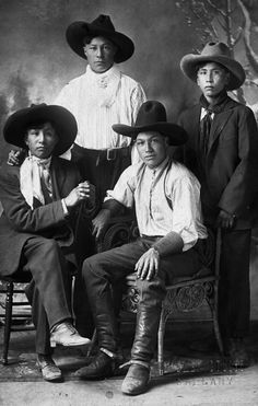 Image No: NA-4951-1  Title: Sarcee [Tsuu T'ina] boys, Calgary, Alberta.  Date: [ca. 1912]  Photographer/Illustrator: Brewer Studio, Calgary, Alberta  Remarks: Studio portrait. L-R: Anthony Dodging Horse; George Big Plume; Frank One Spot; Pat Dodging Horse.  Subject(s): Sarcee - Personalities / Tsuu T'ina - Personalities / Children / Cowboys   Order this photo from Glenbow: ww2.glenbow.org/search/archivesPhotosResults.aspx?XC=/sea...  Search for 99,999 other historical photos at Glenbow…