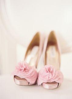 Pink ruffle shoes.