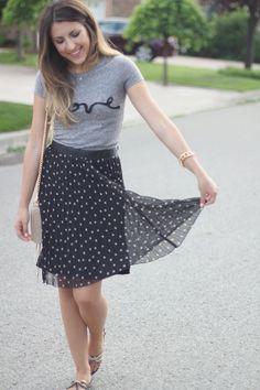 Graphic tshirt and polka dot skirt.
