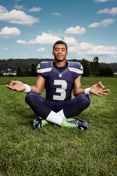 SEATTLE SEAHAWKS RUSSELL WILSON...LOTUS POSE ON TWO. Love RW3, wouldn't trade him for any QB in the NFL. #YeahISaidIt