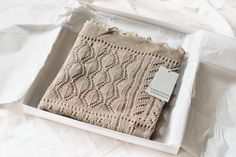 This super-light 100% cotton baby shawl is knitted in a pretty patchwork design of varying lace patterns. Created in a soft porridge shade. Each shawl is lovingly produced at our factory in Nottingham, England, by our artisan skilled and experienced team. #ghhurt #babygift #newborn #babyshawl #babyblanket #christening #christeninggift #babyshower #babyshowers #babyshowergift #babyshowergifts #mumtobe #fatherhood #porridge #beigeaesthetic #beige #beigepalette #shawl #preggo #motherhood Baby Shawl, Patchwork Baby, Beige Aesthetic, Patchwork Designs, Newborn Baby Gifts, Christening Gifts, Lace Patterns, Nottingham, Summer Baby