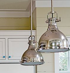 "Powell reinvented vintage elements by varying their scale and finish to create a kitchen that's both classic and unexpected. These strong silver pendant lamps keep with this idea and are casual enough to work in a beachy space. ""Create distinct light sources to illuminate every surface,"" she said."