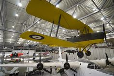 "The legendary Tiger Moth ""flies"" over the Short Sunderland at AirSpace, Imperial War Museum, Duxford, Cambridgeshire, England."