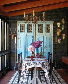 Ornate salvaged doors painted a bright color add interest and texture to a room