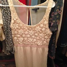 American eagle dress amazing condition, it's knee length and it's a off white and peach color . American Eagle Outfitters Dresses