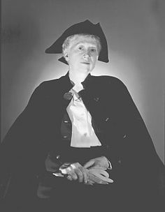 Marianne Moore and trademark three pointed hat.