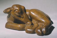 Henri Gaudier-Brzeska 'Sleeping Fawn', 1913, posthumous cast - Painted plaster I In 1913 Gaudier-Brzeska made a carving in Seravezza marble of a sleeping fawn. Like the 'Crouching Fawn' displayed nearby, this was developed from life drawings. Gaudier made a number of such drawings on the same day. The work shown here is a plaster cast based on the original marble. It is among his more naturalistic works, and one of several 'Fawn' sculptures he made.