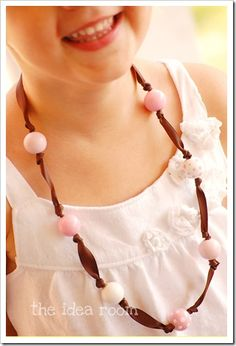 Handpainting wooden beads mean that you can make these pretty ribbon necklaces exactly the way you want them! Great for kids, too.