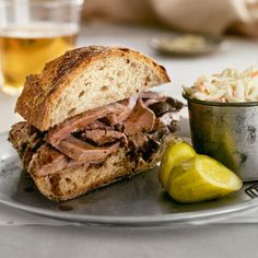 Spicied beed sandwich with pickels and coleslaw... all of Eric's favorite things!