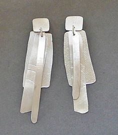 "Kathleen Faulkner: Wind Letter Earrings, Sterling silver earrings. Approx 3"" long."