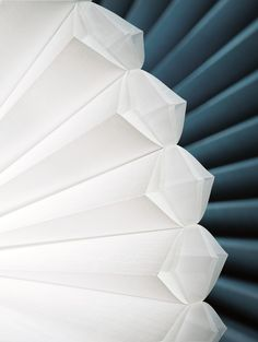 Duette® Architella® Trielle™ Shades provide three layers of honeycombs for superb energy efficiency. Smart choice. Wonderful for drafty bedroom windows.