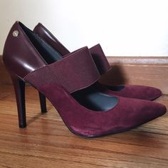 Calvin Klein Nessah Maryjane Pumps Calvin Klein suede heels in burgundy. Elastic band on the front. There is a little wear on the heel but they are in overall very good condition. Size 6.5 Calvin Klein Shoes Heels