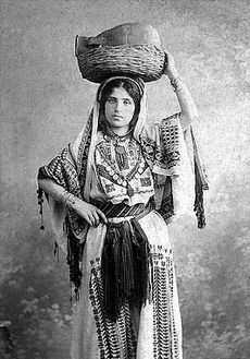 Woman in Ramallah costume. Photographed by Khalil Raad, 1920.