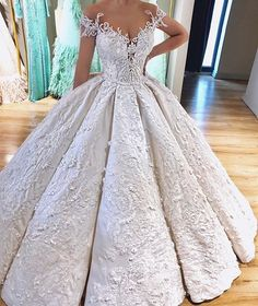 This ball gown style wedding dress is ornate and detailed. Brides who love a haute couture wedding gown but cant afford the cost can request us to make a #replica of the dress for them. Our version will have the same style & look but cost way less. Get more info on custom #weddingdresses & replicas when you email us from our main website.
