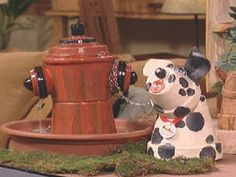 dalmatian and hydrant clay pot fountain.  I think this is such a cute DIY project!  So clever!