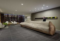 Odada Design. The reception desk of The Hotel Paradox in Santa Cruz, CA Hotel is a 25-foot-long, eucalyptus log