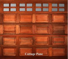 A wooden garage door in Cottage Pane style.