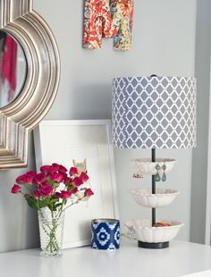 What a great lamp for a vanity...i could make this from bowls I love, and hang earrings from rims, and store other jewelry in the bowls. I love the fabric covered M