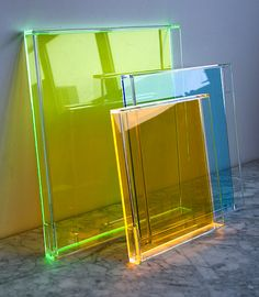 Trays that glow when light shines on them - made from cell cast acrylic and the faceted and beveled edges help reflect and magnify color. - Design*Sponge