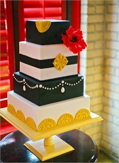black, red, white and yellow wedding cake